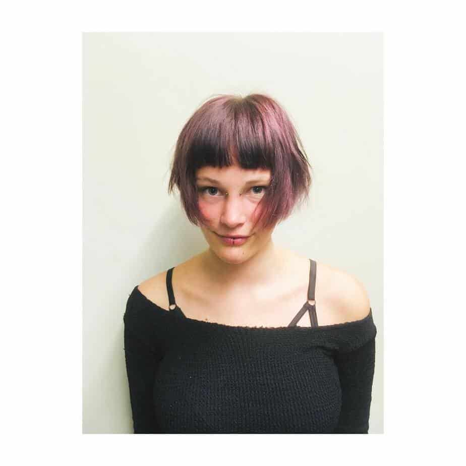Latest bob haircuts 2022 with messy strands and choppy bangs