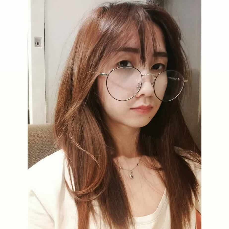 Light brown hair with long bangs