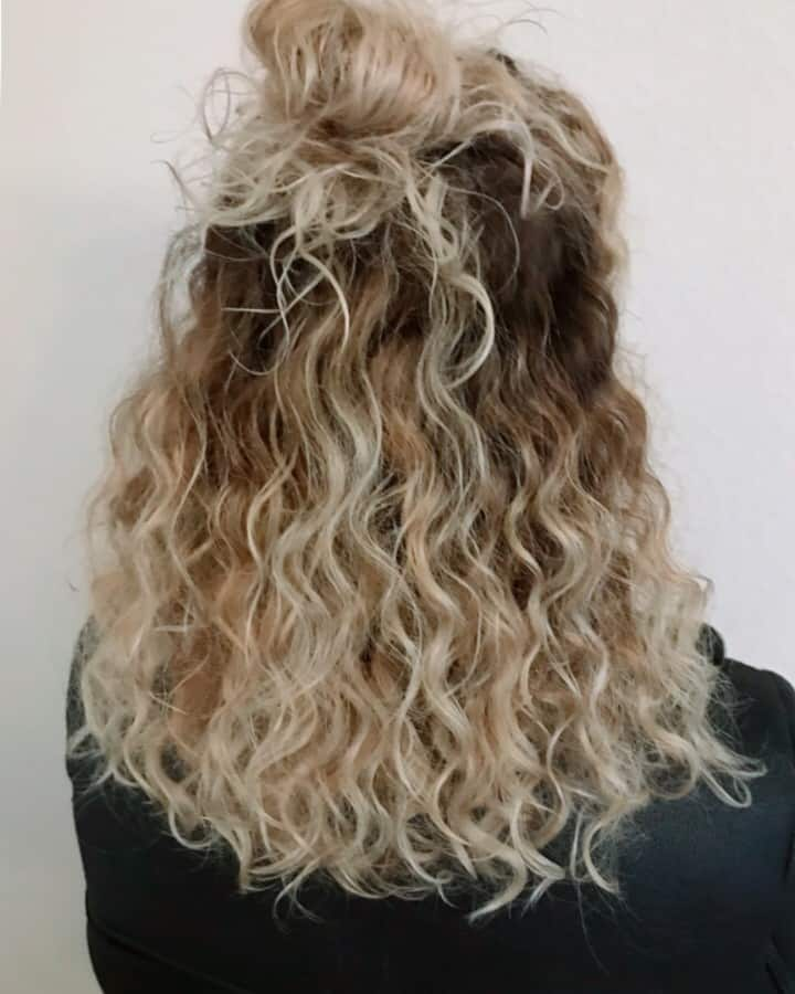 Half bun with wavy curls