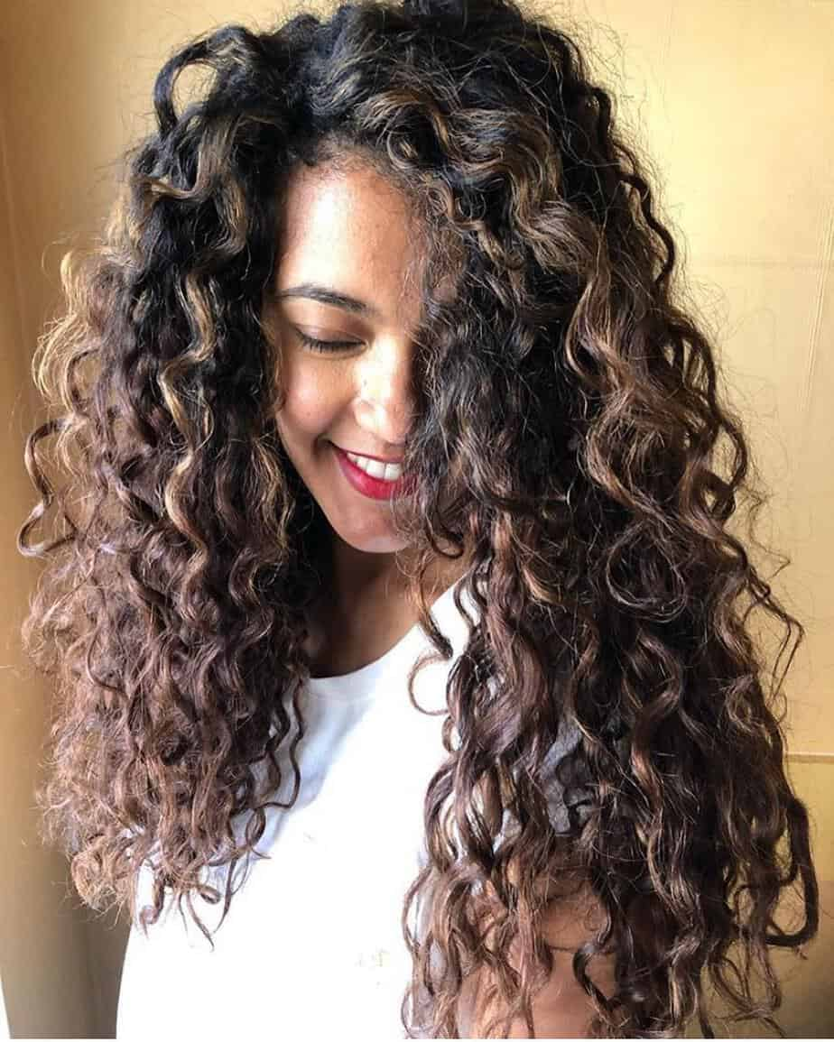 Dark color balayage on haircuts for long curly hair 2020