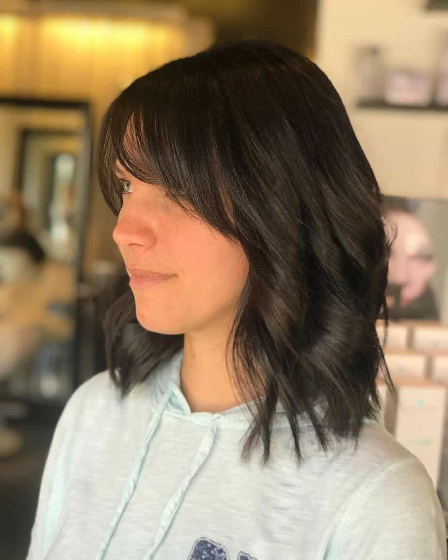 Layered short hairstyles 2020 with choppy layers and wispy bangs