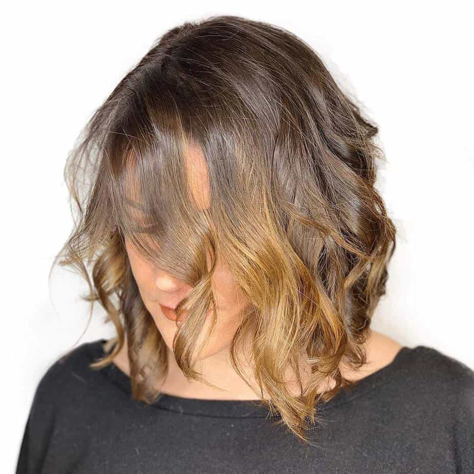 medium length hair trends 2020 Deep side parting